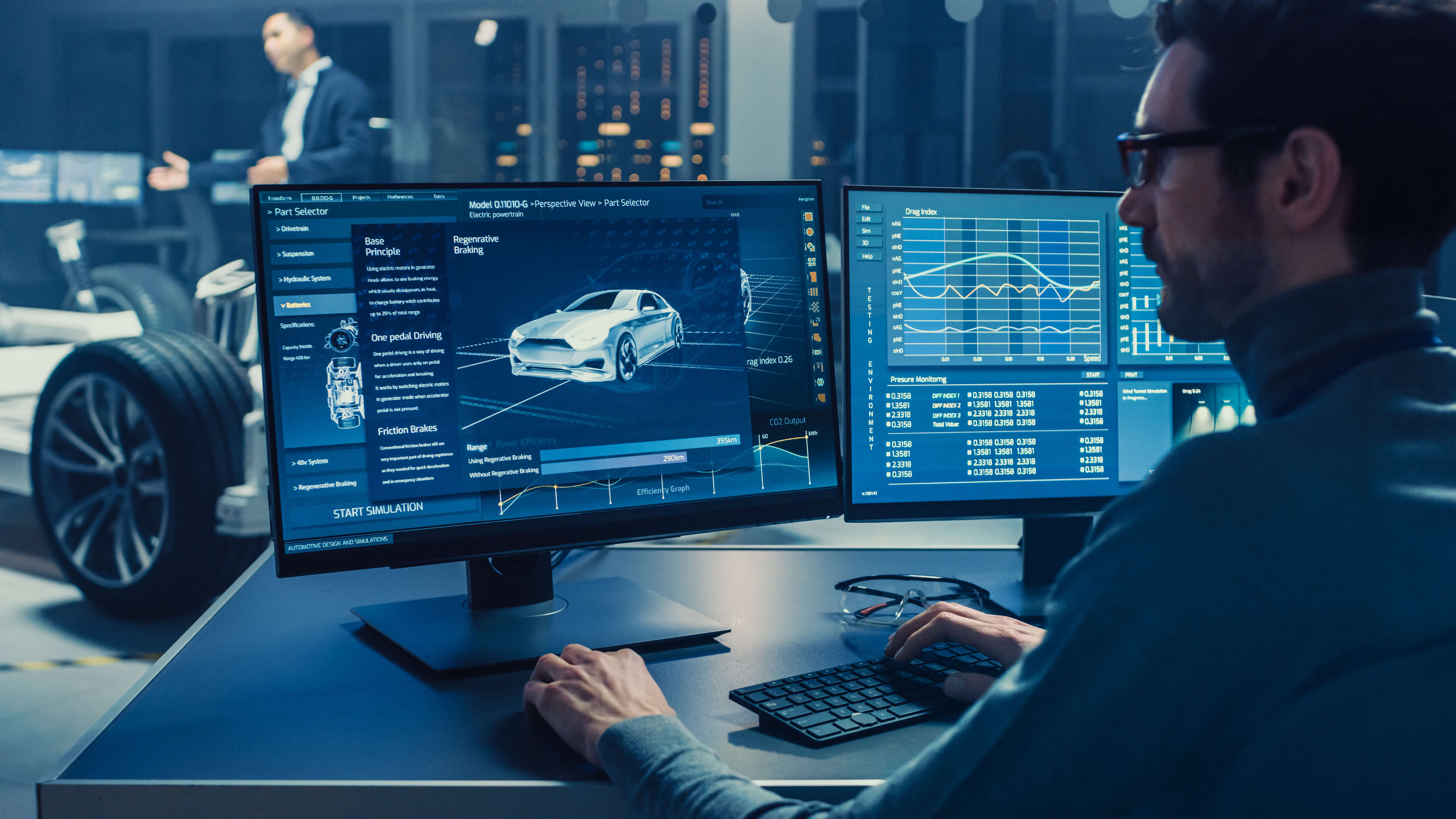 person working at computer with UI interface of vehicle information