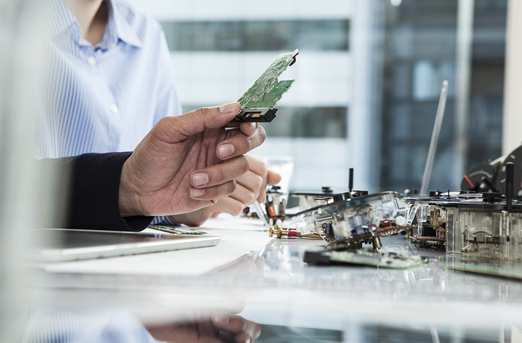 People working on circuit boards in lab