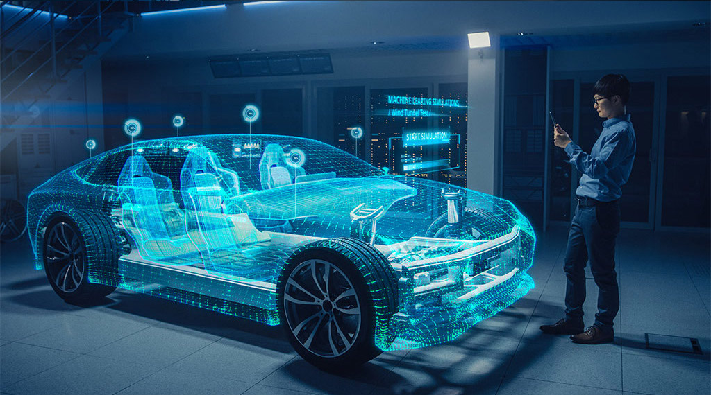 engineer standing in front of holographic car with tablet